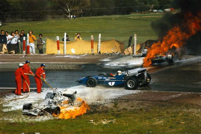Formula One Racecars Burning After Accident