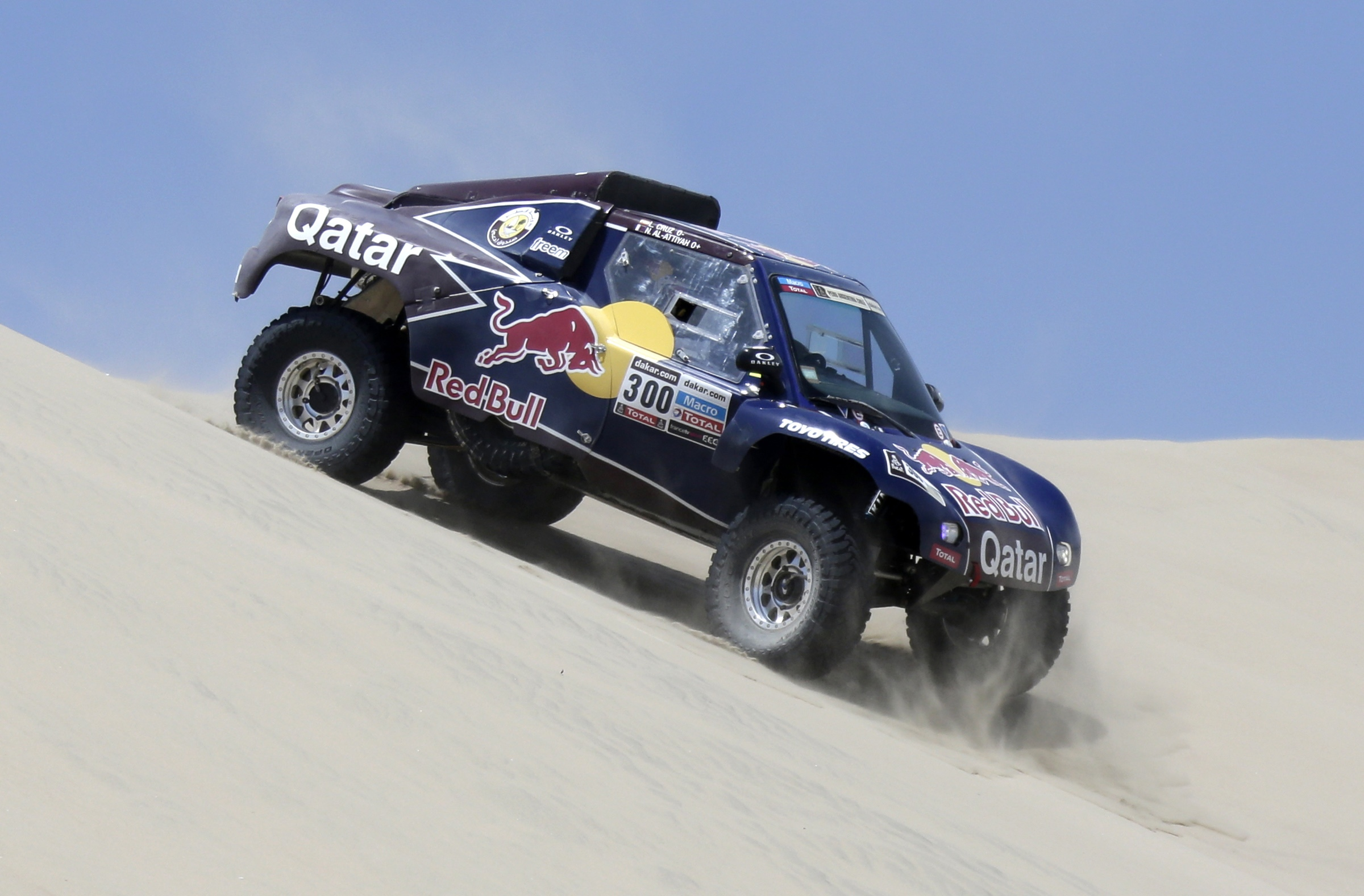 Qatar's Al-Attiyah and co-pilot Spain's Cruz compete with their Buggy during the second stage of the 2013 Dakar Rally from  Pisco to Pisco