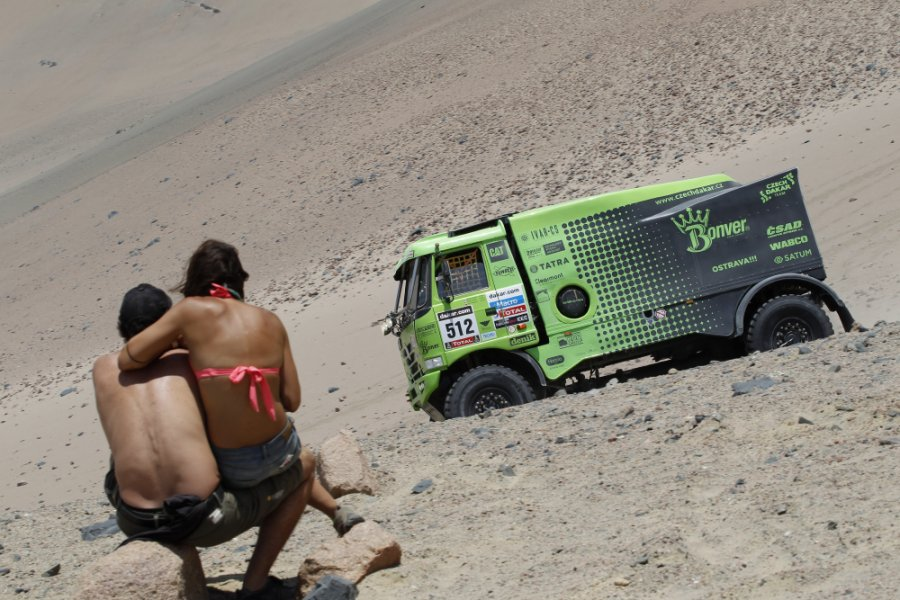 two-onlookers-get-some-sun-near-the-parked-truck-driven-by-tomas-vratny-and-milan-holan-of-the-czech-republic