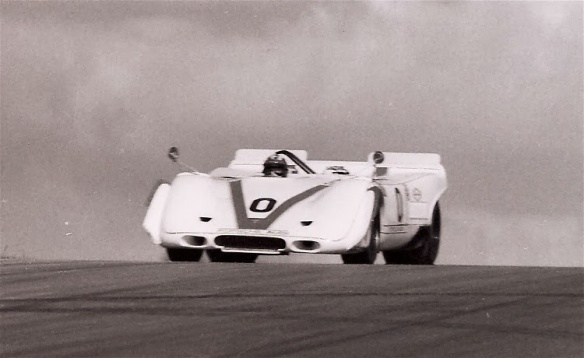 Jo Siffert & Sterling Moss at the 1969 Michigan CanAm race. 4