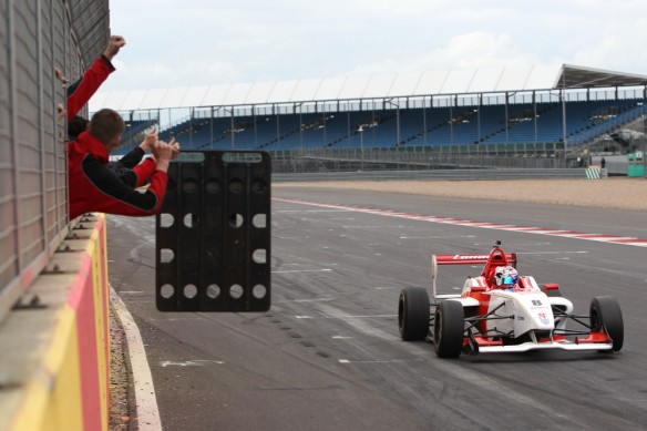 George Russell crosses the line to take his first F4 win